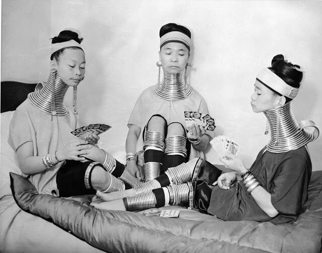 The Padaung giraffe women playing cards